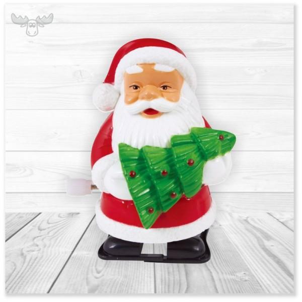 Laufender Weihnachtsmann zum Aufziehen mit Tannenbaum