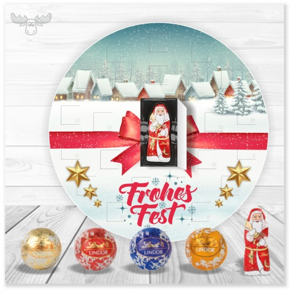 Runder Adventskalender mit Lindor-Kugeln und Schoko-Weihnachtsmann Motiv Dorf