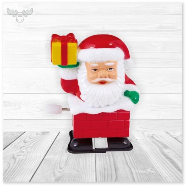 Weihnachtsmann mit Geschenk zum Aufziehen