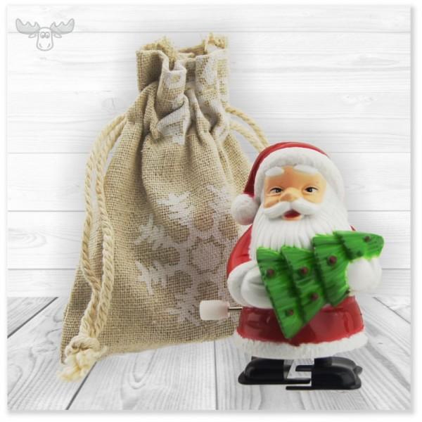 Aufzieh-Weihnachtsmann im Säckchen mit Tanne